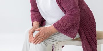 Lady Holding Painful Knee